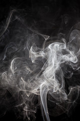 White smoke on a black background.