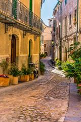 Wall Mural - Beautiful view of an mediterranean alleyway with old buildings