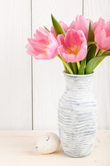 Fresh pink tulips and Easter egg