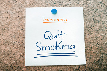 Quit Smoking Reminder For Tomorrow On Paper Pinned On Cork Board