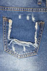 Blue torn denim pocket background.