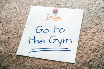 Go To The Gym Reminder For Today On Paper Pinned On Cork Board