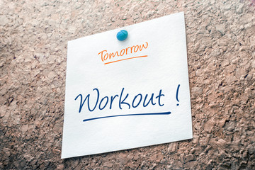 Workout Reminder For Tomorrow On Paper Pinned On Cork Board