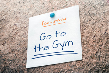 Go To The Gym Reminder For Tomorrow On Paper Pinned On Cork Board