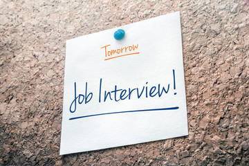 Job Interview Reminder For Tomorrow On Paper Pinned On Cork Board