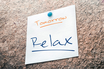 Relax Reminder For Tomorrow On Paper Pinned On Cork Board