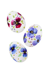 Easter eggs with violets isolated on a white background