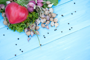 Fresh vegetables on natural wooden blue background. Russian traditional vegetables.