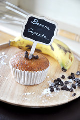 Banana Cupcake with Label on wooden Plate