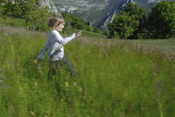 Little girl running through a meadow