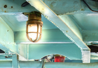 Old lamp / Old lamp on ceiling of boat.