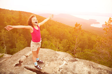 happy girl on the mountain top