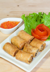 Fried Chinese Traditional Spring rolls food isolated on wood bac