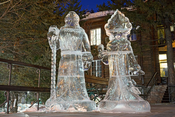 Snow maiden and Santa claus grandfather - Ice figures at night, in the street of Irkutsk, Siberia, Russia. Yhe pure ice is from Baikal lake.