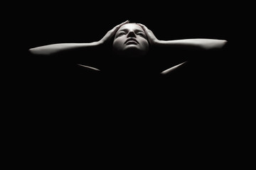 girl holding the face like a mask.woman body dark female silhouette