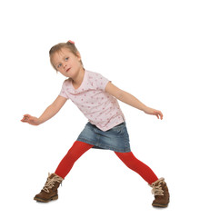 Cheerful little girl playing spread wide his arms - Isolated on white background