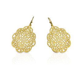 Gold filigree earrings isolated on white with a reflection