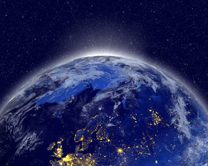 Planet earth with appearing sunlight. Visible city lights. Elements of this image furnished by NASA.