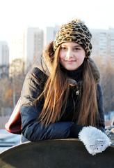 young cute girl in winter clothes