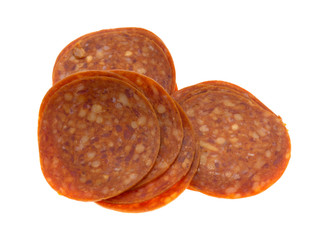 Slices of pepperoni on a white background.