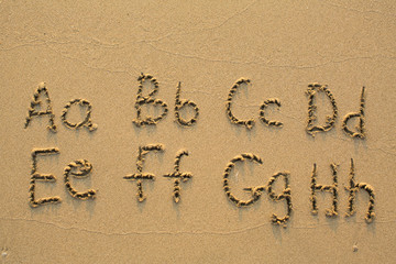 Alphabet written in light beach sand, part 1 of 4 (A-H)