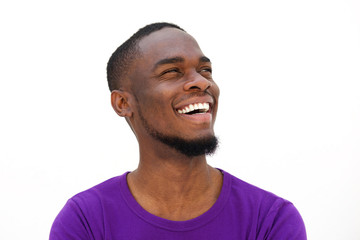 Laughing young african american man with beard