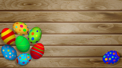 Easter eggs on wooden planks