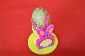 Colored egg on holder