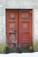Old Wooden Door Painted in dark red color. Vintage Weathered Entry