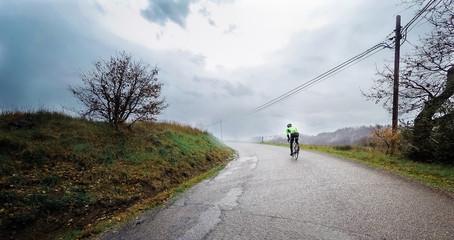 cyclist training under the rain. Pov, original point of view