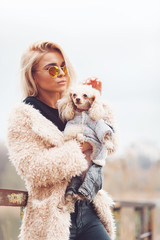 young caucasian cute girl portrait with dog outdoor in park walking happy and smile all the way