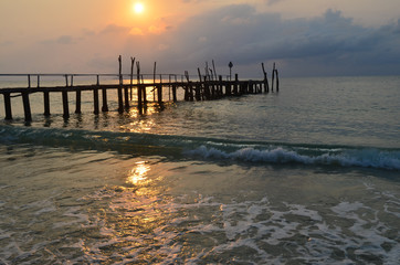 Old wood pier, sunset, Koh Samet island, Thailand