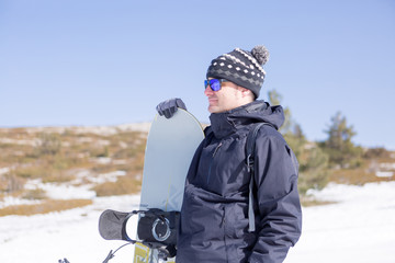 Peaceful man with snowboard