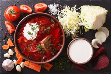 Ukrainian borsch soup with ingredients on slate. horizontal top view