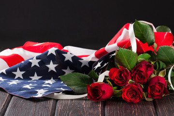 Rose and american flag on wood