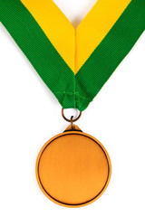Gold medal on white background with blank face for text, Gold medal in the foreground on yellow green ribbon.