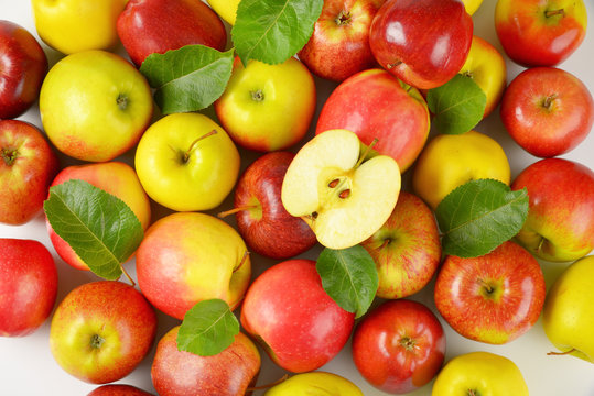 heap of red and yellow apples