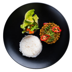 Spicy thai food fried pork with yellow curry, steamed rice and boiled vegetables