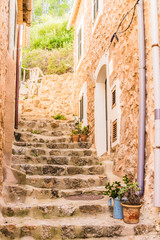 Wall Mural - View of old stone stairs of an mediterranean mountain village