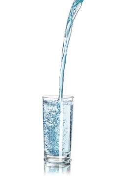 a strong pouring water pouring into a glass isolated on white ba