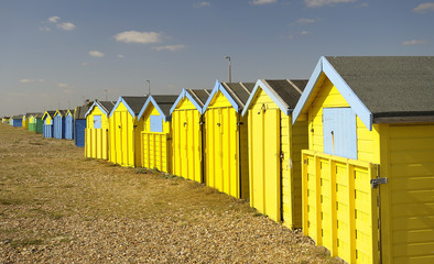 Yellow beach huts,England.