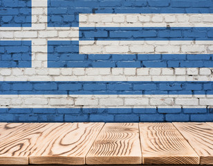 Greece flag painted on brick wall with wooden floor