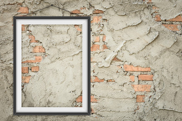 Blank picture frame on a bricks concrete wall