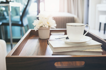 Home Interior with Coffee cup Book white flower on table wooden