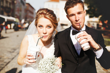 young luxury gorgeous happy bride and groom on the background of