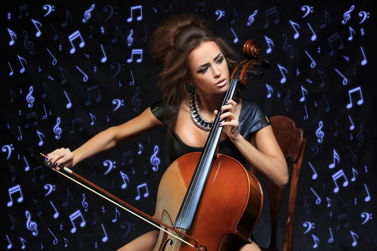 Pretty young female musician playing the cello