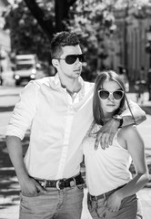 young couple in sunglasses in summer, city outdoor, black and white photography