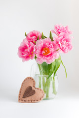 Pink tulips in a glass jar