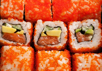 Sushi rolls with salmon, cheese and red caviar