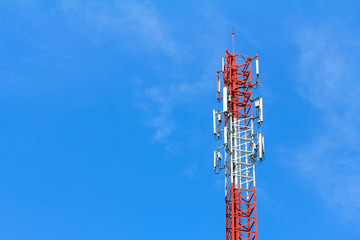 Cell Phone Antenna Tower in blue sky